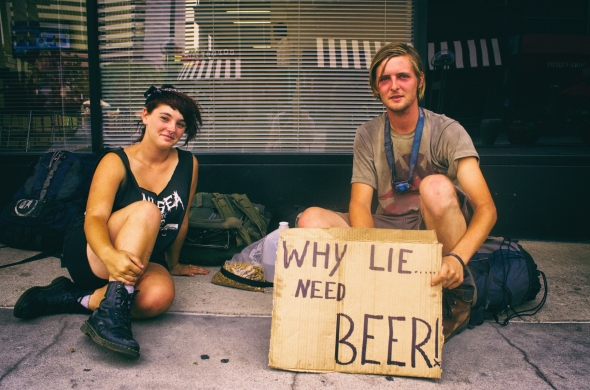 A young couple panhandling on the 16th Street Mall in Denver. According to a January 2014 survey conducted by the  Metro Denver Homeless Initiative  there are currently around 5,812 homeless people in the Denver Metro area.
