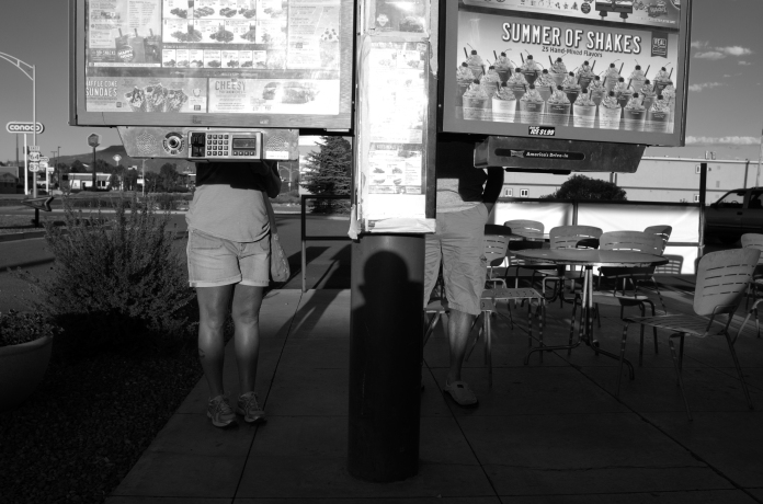 RATON, New Mexico-August 31, 2014- Patrons at the local Sonic Drive-In contemplate the menu in the late afternoon sun.