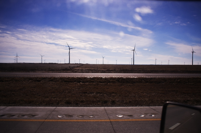 Somewhere along I-70 West, Kansas-December 27,2014-Wind Turbines seen along the highway in Kansas. The state is prime territory for generating wind power.  According to the U.S. Energy Information Administration, Kansas has the potential to provide 3,102 TW·h of electricity each year. That is about 75% of all the electricity generated in the United States in one year.