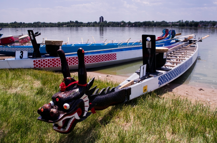 "DENVER,Colo.-July 20, 2014-A pair of Taiwan-style dragon boats rest on the shore of Sloan's Lake. 2014 was the 14th year for the festival. More than 100,000 people attended. ""The mission of the Colorado Dragon Boat Festival is to build bridges of awareness, knowledge and understanding between the diverse Asian Pacific American (APA) communities and the general public through cultural education, leadership development, and athletic competition"""