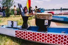 "DENVER,Colo.-July 20, 2014-A pair of Taiwan-style dragon boats rest on the shore of Sloan's Lake. This was the 14th year for the festival and more than 100,000 people attended. ""The mission of the Colorado Dragon Boat Festival is to build bridges of awareness, knowledge and understanding between the diverse Asian Pacific American (APA) communities and the general public through cultural education, leadership development, and athletic competition"""