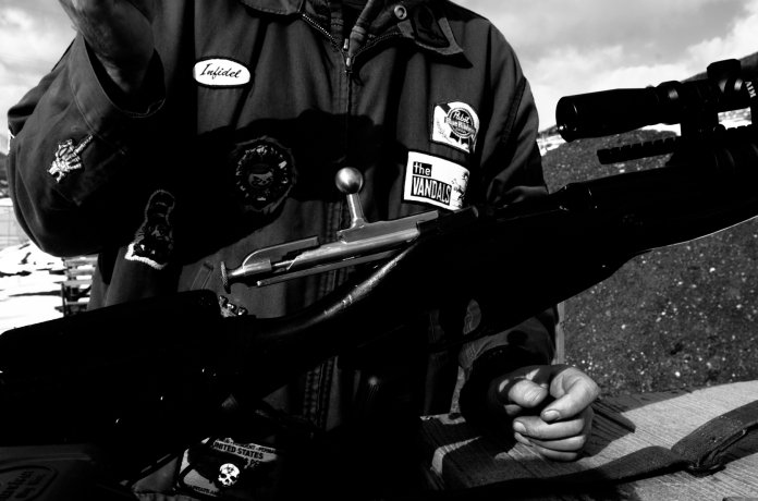DILLON,Colo-Ben prepares to load his weapon at the Summit County Shooting Range. The range is provided as a community service by Summit County and is maintained by volunteers.